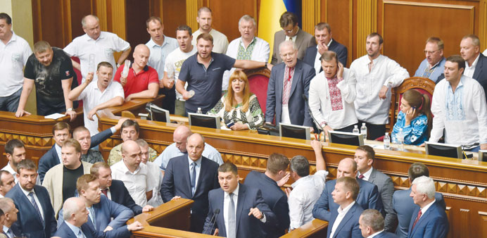 Deputies of the Ukrainian Radical Party block the platform to prevent voting at the parliament in Ki