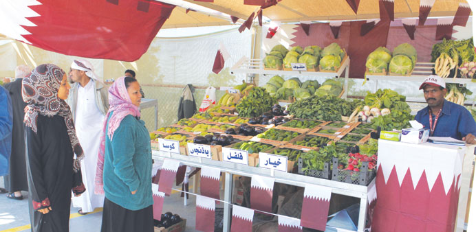People visiting a vegetable stall at Al-Mazrouah Yard on Thursday. PICTURE: Othman al-Samarraee