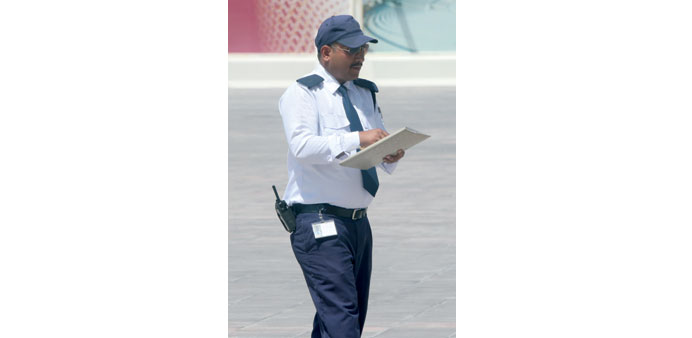 A security guard on duty on an open ground in Doha. PICTURE: Jayaram