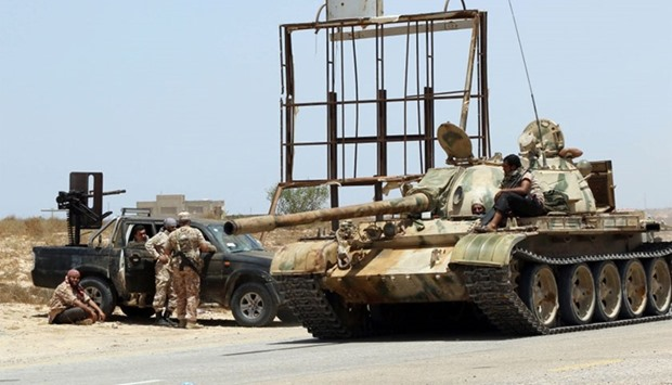 Forces loyal to Libya's UN-backed unity government gather around a tank in sirte