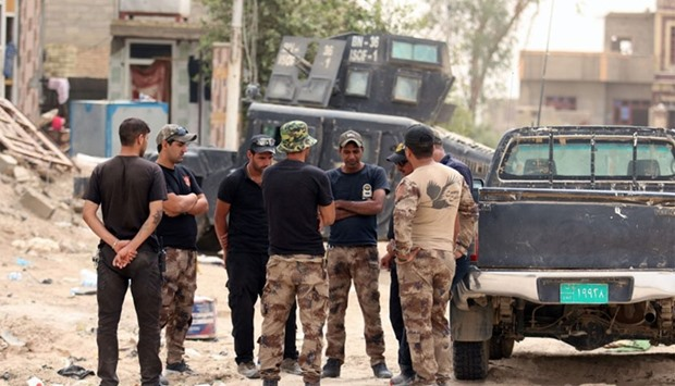 Members of the Iraqi counter terrorism forces gather next to their vehicles in Fallujahh's southern