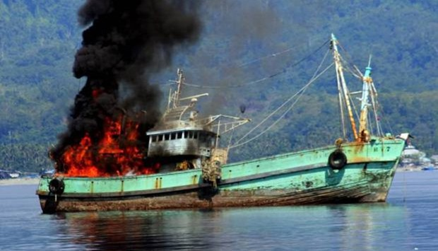 fishing boats on fire