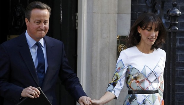 Britain's Prime Minister David Cameron leaves 10 Downing Street with his wife Samantha