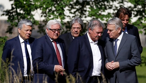 Ministers walk through the Park of the German Foreign Ministery guest house before a foreign ministe