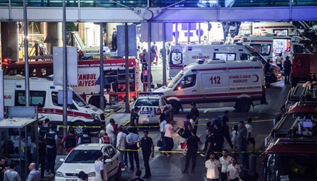 Forensic police work the explosion site at Ataturk airport  in Istanbul