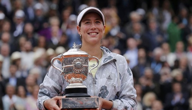 Garbine Muguruza poses with the trophy after beating Serena Williams. Reuters