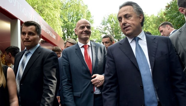 FIFA President Gianni Infantino (2nd L) and Russia's Sport Minister Vitaly Mutko (R) walk during the
