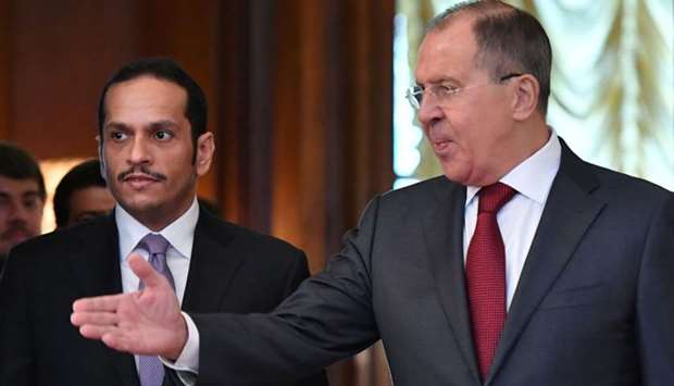 Russian Foreign Minister Sergei Lavrov (R) welcomes Qatar's Minister of Foreign Affair HE Sheikh Moh