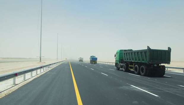 Traffic moves on the newly opened Hamad Port-Industrial Area road