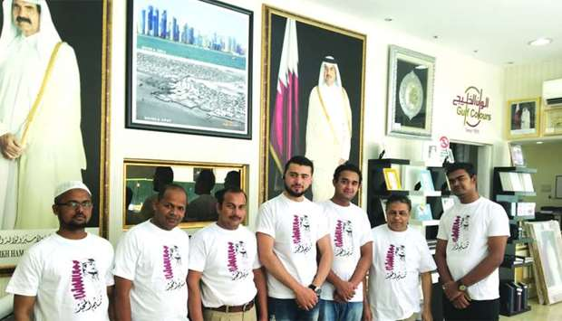 Employees of a private firm wearing T-shirts supporting Qatar.