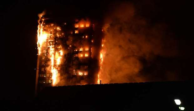 Flames engulfing a 27-storey block of flats in west London. Picture taken by local resident Giulio T