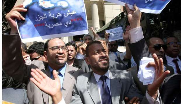Protesters shout slogans and hold a banner that reads in Arabic 'two Red Sea islands are Egyptian',