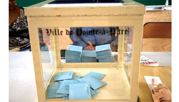 This picture taken yesterday shows ballots in the box during the second round of the French legislat