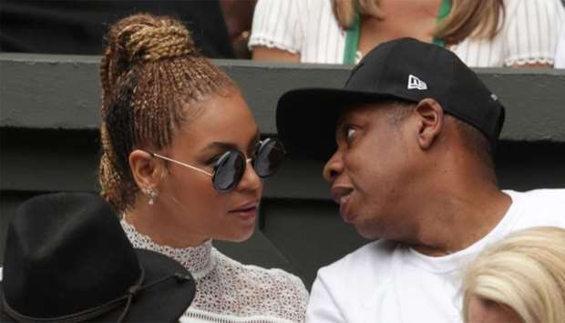 US singer Beyonce (L) and her husband US rapper Jay Z (R)