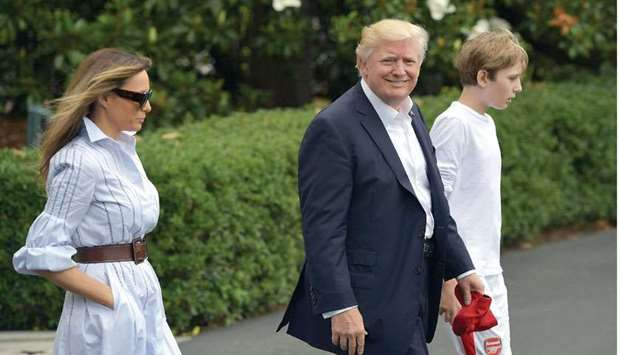 President Donald Trump, First Lady Melania Trump, and son Barron make their way to board Marine One