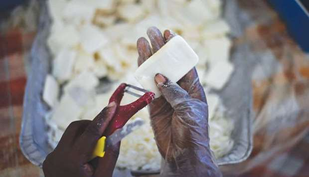 An Anacaona staffer cleans used soap collected from a hotel in Port-au-Prince.