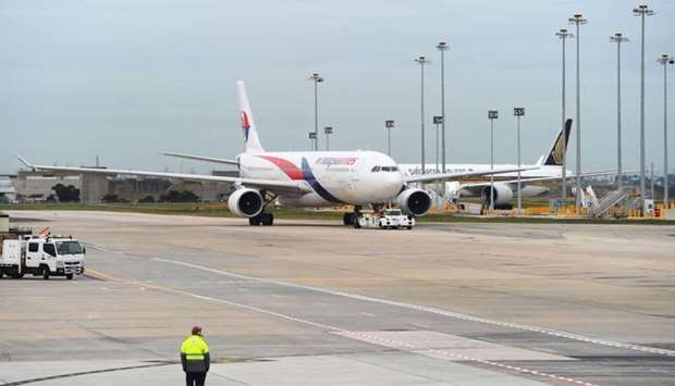 Armed police stormed a Malaysia Airlines flight which was forced to return to Melbourne after a pass