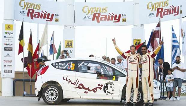 Qatar's Nasser al-Attiyah (right) with his co-driver Matthieu Baumel during the start of the Cyprus