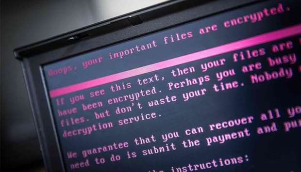 A laptop displays a message after being infected by a ransomware