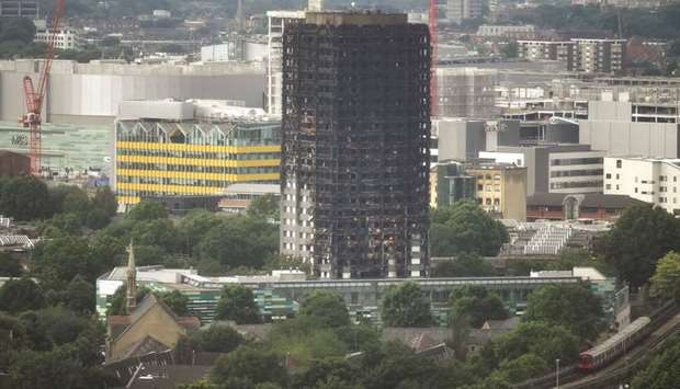 The burnt out remains of the Grenfell apartment tower are seen in North Kensington, London, Britain,