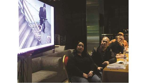 Police and Bureau of Fire officials, and Resorts World representatives watch surveillance video foot