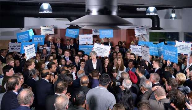 British Prime Minister Theresa May (C) speaks during a general election rally