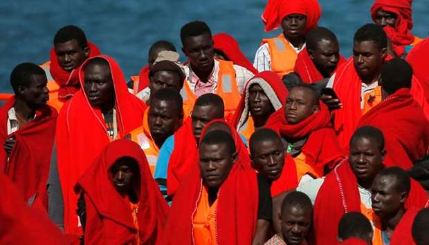 Migrants, part of a group intercepted aboard two dinghies off the coast in the Mediterranean Sea