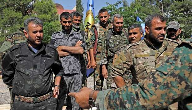 Members of the leading Syrian Kurdish militia, the Manbij military council wait prior to a press con