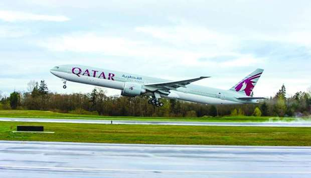 A Qatar Airway's 777-300ER taking off from Everett.
