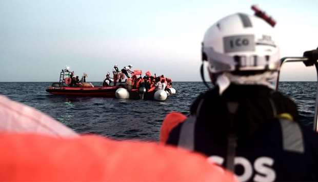 SOS Mediterranee NGO shows migrants being rescued before boarding the French NGO's ship Aquarius.