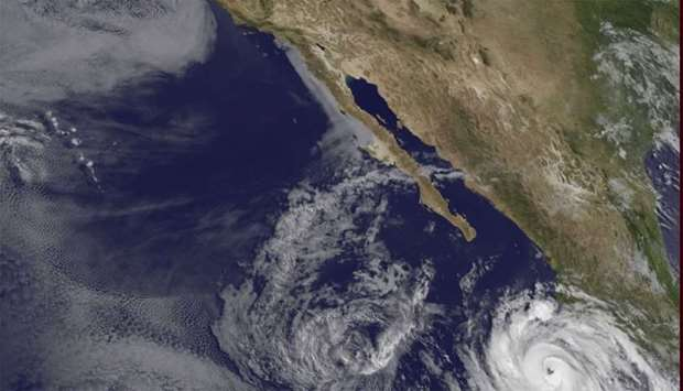 Satellite image  shows hurricane activity in the north Pacific, west of Mexico.