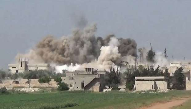 Smoke rises after an air strike in Ltamenah.