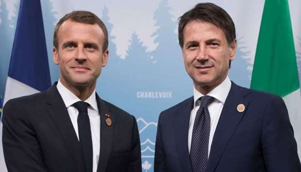 French president Emmanuel Macron (L) with Italian Prime Minister Giuseppe Conte