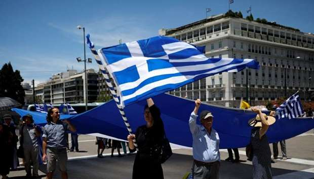 Protesters demonstrate against the agreement reached by Greece and Macedonia to resolve a dispute ov
