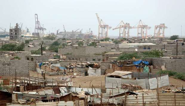 Hodeidah port's cranes are pictured from a nearby shantytown in Hodeidah, Yemen.