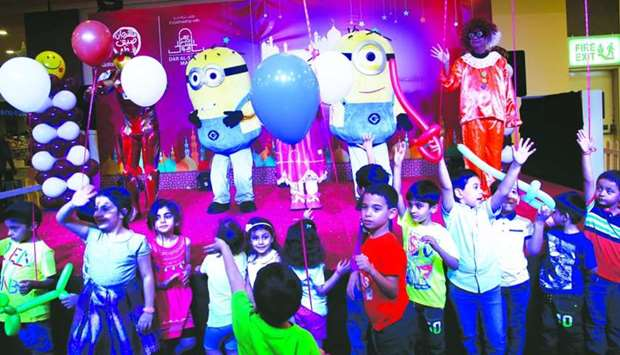Children enjoy a performance on Sunday at Dar Al Salam Mall in Doha as part of the Qatar Summer Fest