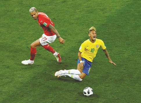 Under-cooked Neymar hobbled by rough Swiss