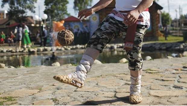 Wearing bast shoes, fans test their skills at Mordovian football