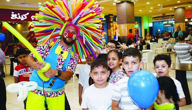 A performer entertains children at Dar Al Salam Mall. PICTURE: Jayaram