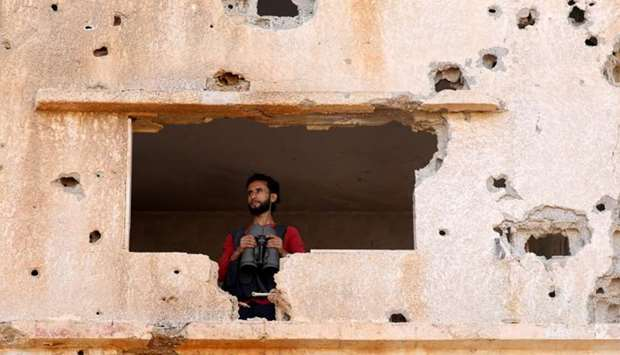 A fighter from the Free Syrian Army is seen in Yadouda area in Deraa, Syria