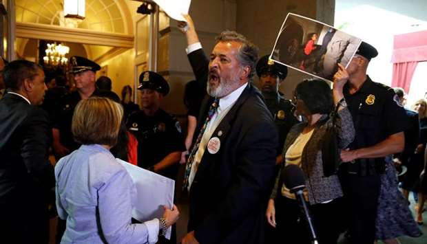 Rep. Juan Vargas (D-CA) and other Democratic members of Congress protest family separations at the U