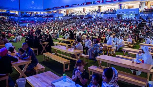 Thousands of people from various communities in Qatar gather at the Ali Bin Hamad Al Attiyah Arena t