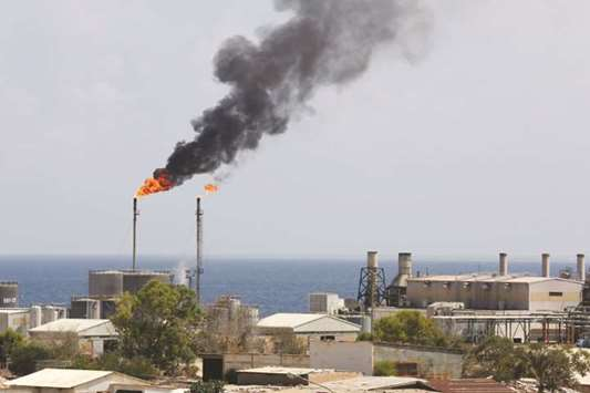 Clashes at Libya oil ports cut output by nearly half