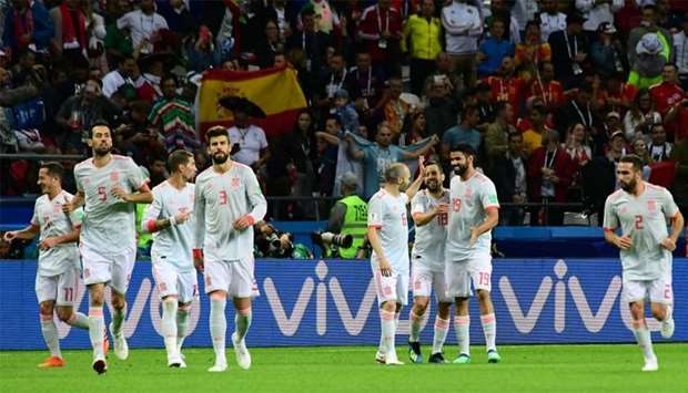 Spain's forward Diego Costa (2nd R) celebrates his goal with teammates during the match against Iran