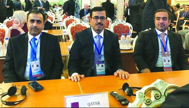 HE the Minister of Energy and Industry Dr Mohamed bin Saleh al-Sada is flanked by Kahramaa president