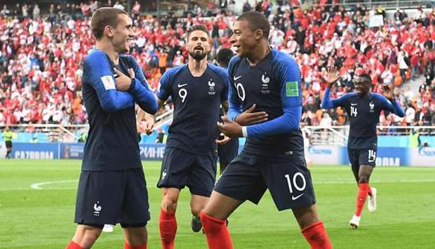 France's forward Kylian Mbappe (R) celebrates scoring the opening goal with his teammates forward An