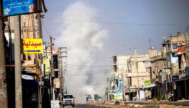 Smoke plumes rising from regime bombardment in Al-Hirak in the eastern Daraa province countryside in