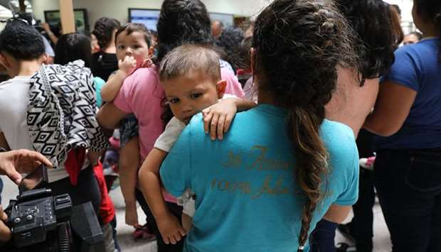 Dozens of women and their children, many fleeing poverty and violence in Honduras, Guatamala and El