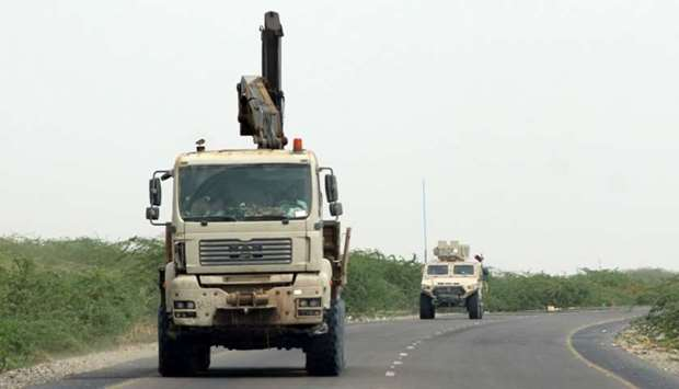 A truck crane and an armoured vehicle belonging to the Amalqa  Brigades