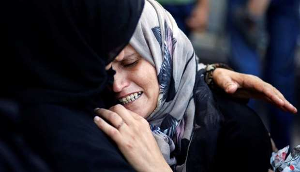 A relative mourns during the funeral of Osama Abu Khater.